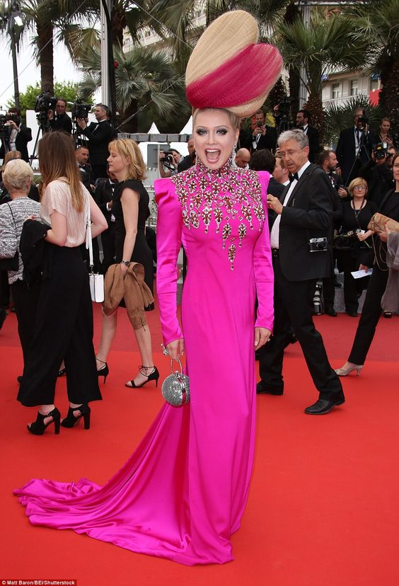 Vibrant: Elena Lenina certainly made a statement in a shocking pink gown with a matching s...: