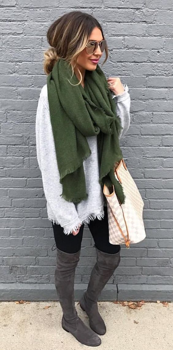 green scarf with gray over the knee boots: