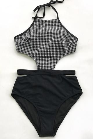 The black gingham pattern is never old-fashioned. This one piece feasures design elements like halter...