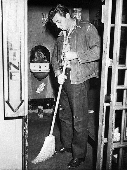 robert mitchum sweeps his jail cell after getting busted for marijuana possession in 1948.