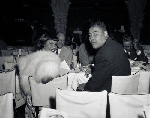 Boxing legend Joe Louis and singer Dolores Parker, photographed in November 1952 at the French Casino in New York to watch the theatrical debut of then Middleweight champion, Sugar Ray Robinson, who was making his debut as a dancer. Photo: Bettmann/Corbis. | Vintage Black Glamour by Nichelle Gainer