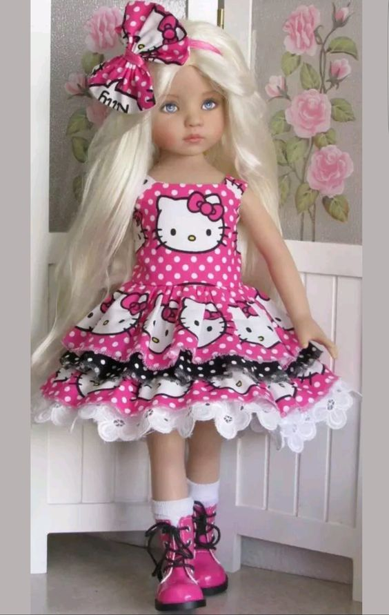 Hand-knit Kitty sweater and dress set made for Effner Little darling dolls ebay seller kalyinny