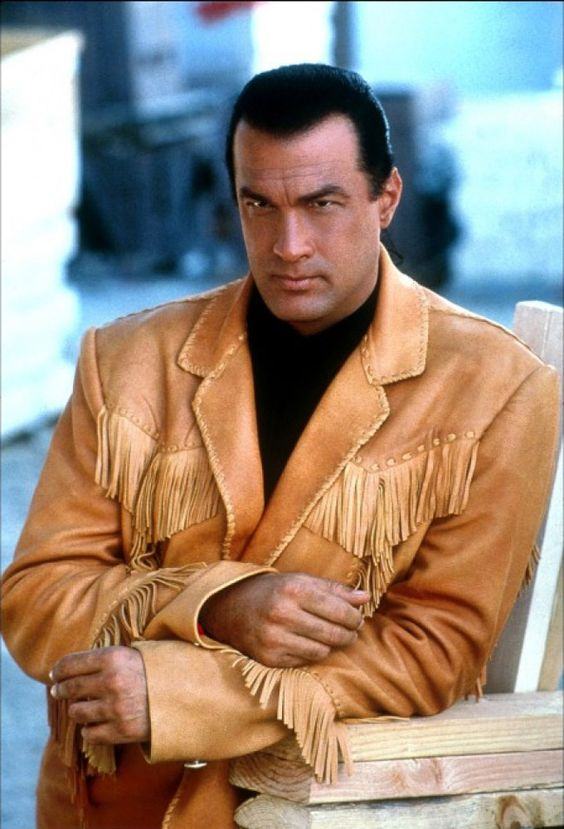 Steven Seagal for the hero or villain. He was considered more than once to be in the expendables franchise and turned it down. He's got a lot of charisma in all his movies and he's perfect for the franchise. This time he should be in this franchise.