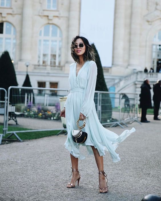 Aimee Song wears blue pastel Chloe dress, Chloe bag and sandals sudring Paris fashion week. How to Wear Pastels - Pastel Colors Outfit Ideas | Fab Fashion Fix.  #spring #springstyle #fashion #fashiontips #outfits #pastels #pastelcolors #fabfashionfix #chloe #chloedress #chloebag #bluedress #aimeesong