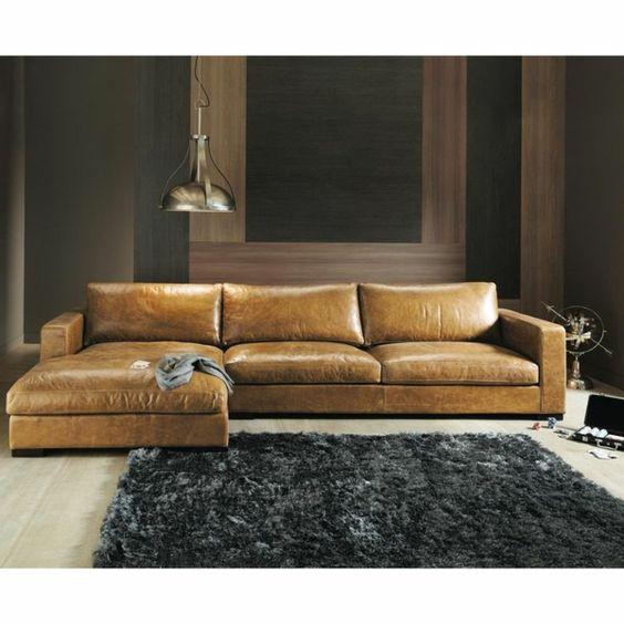 Eckcouch aus Leder hell braun teppich