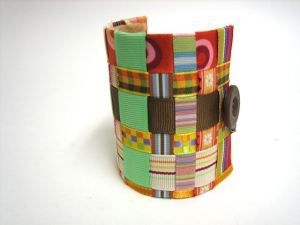 For Earth Day, make DIY Cuff Bracelet out of cardboard toilet paper rolls and scrap ribbon.