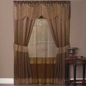 "Taupe.  Six Piece ""Window In A Bag"" Set. Two luxurious elegant satin panels enhanced with attached voile under-panel and a string Austrian valance. Panels are detailed on bottom with tassel fringe and also include matching tassel fringe tiebacks. Requires just one standard or decorative rod. Set Includes: 2 Satin Panels w/Fringed Bottom 1 Solid-Color Voile Panel 1 Silky String Austrian Valance 2 Tasseled Tiebacks"