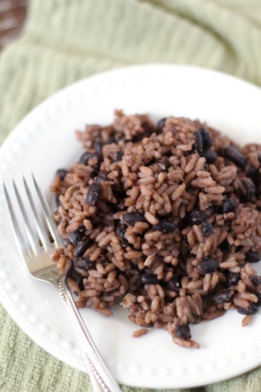 I just had this tasty dish at a dinner party.  Congri | Moros - Black Beans & Rice cooked together