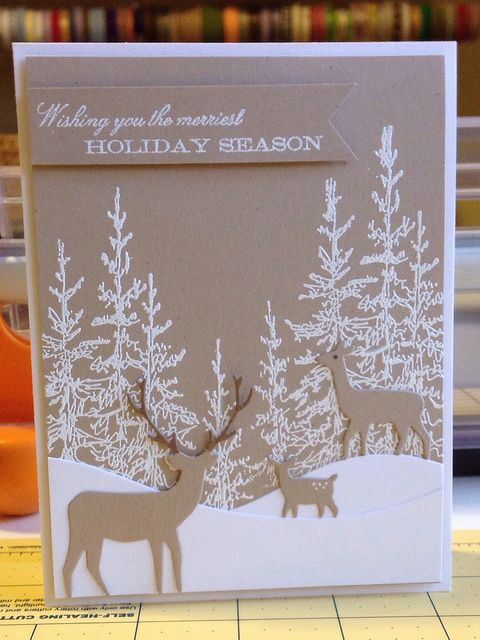 handmade Winter season card ... kraft base and die cut deer family ... white stamped evergreen and landscape lines ... beautiful card ...