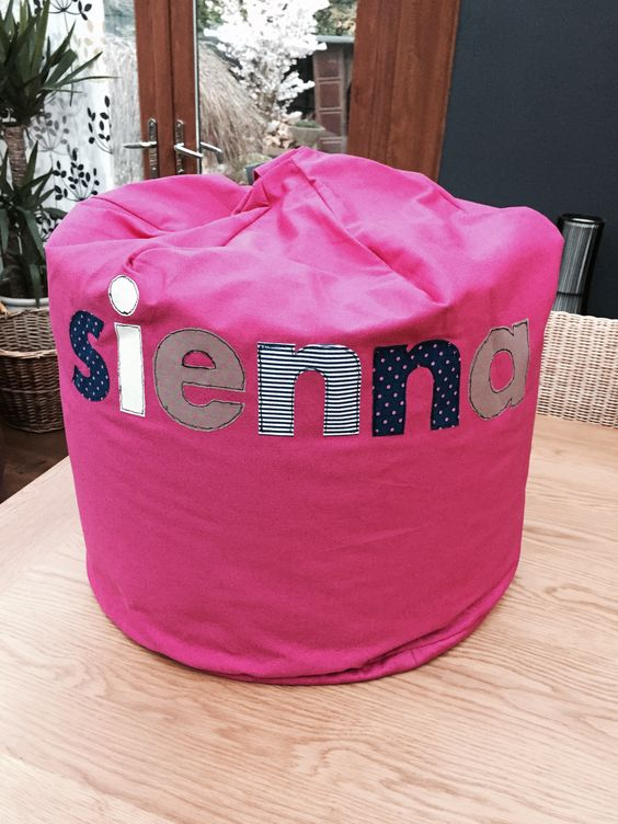 Child's Bean Bag crafted for my Goddaughter Sienna's 3rd birthday. I didn't have time to make the beanbag (I had every intention on making one, honestly). Anyway, I cheated and bought one but there are some fab free patterns for making beanbags on Pinterest. I did make the letters though and sewed them onto the bag using free motion embroidery. I've never done machine embroidery before so watched a few tutorials and loved doing it.  It actually turned out OK I thought but don't zoom in : )
