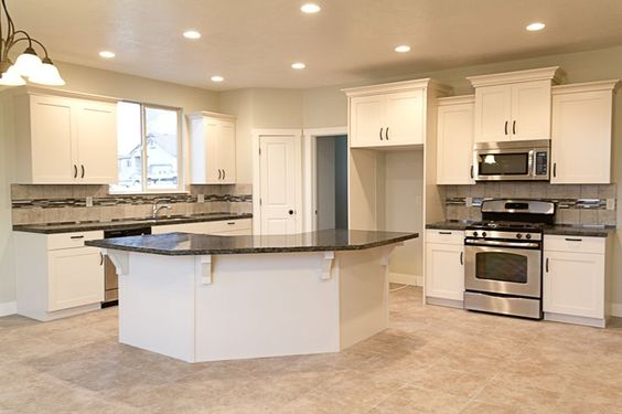 white kitchen cabinets with verde butterfly granite granite countertops and cabinets on 29047