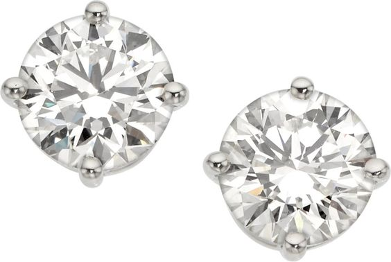 Diamond, Platinum Earrings, Tiffany & Co. The earrings feature round brilliant-cut diamonds measuring 9.14 - 9.23 x 5.70 mm and 9.19 - 9.27 x 5.75 mm weighing 3.01 carats each, set in platinum, marked Tiffany & Co. D and E color, VVS2 clarity. Gross weight 6.52 grams.