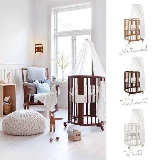 Beautiful oval shaped Scandinavian designed white crib Stokke - babymobel design idee stokke permafrost