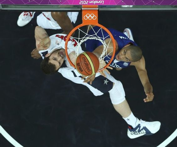 France's Nicolas Batum (R) tries to defend Kevin Love of the U.S during their men's Group A basketball match at the London 2012 Olympic Games in the Basketball arena  July 29, 2012.