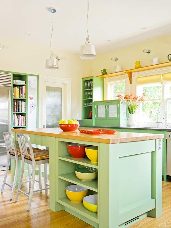Fresh Kitchen-Garden bounty-inspired hues are fresh, flexible, and capable of laying groundwork for a kitchen color palette. With clever storage and a bit of whimsy, the asparagus-green island perks up this kitchen. The color also makes an appearance on perimeter cabinets and trim on the built-in shelves. A muted corn yellow colors the walls, and tomato-red and squash-yellow accessories complete the fresh-from-the garden look