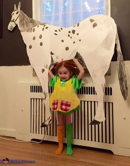 Erica: My daughter is wearing the costume. She wanted to be Pippi Longstocking for her birthday. I made Pippis House Villa Villa Kula from paper and ribbon from the dollar store....
