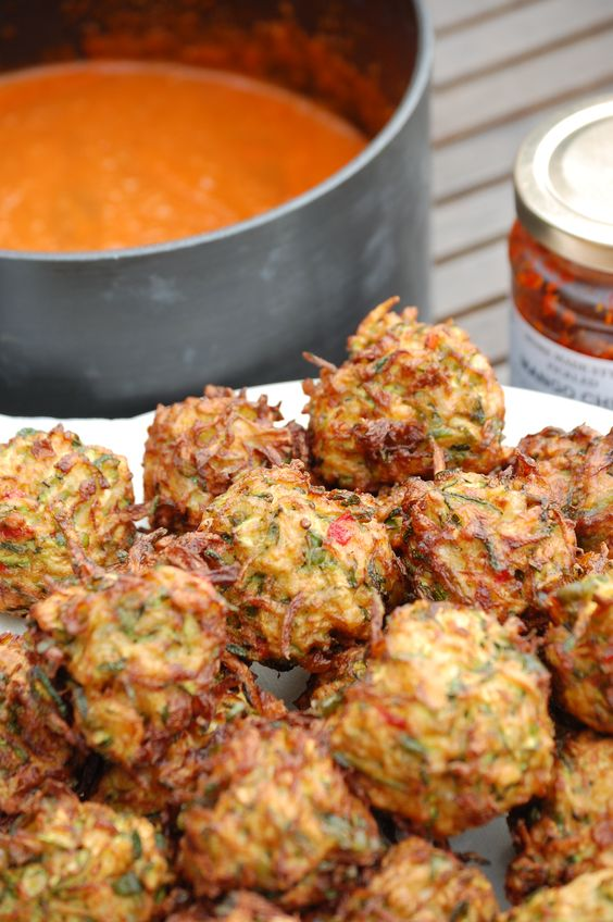Thank goodness for Madhur Jaffery. Another good way to use some of the glut of courgettes. These delicious deep fried balls, baked in a spicy tomato sauce are perfect with rice or breads and a doll...
