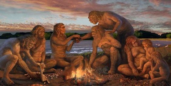 Early Human group gathered around a fire