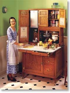 A Hoosier Cabinet from the early 1900's created a more efficient kitchen design with it's built-in features, extra storage, and additional workspace. Courtesy of Kennedy Hardware.: