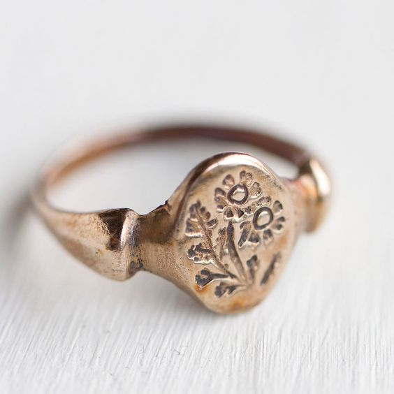 """Bronze Feverfew Ring:"