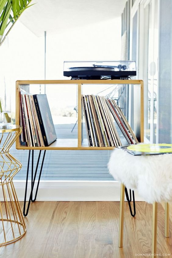 Exclusive: Tour Claire Thomas' Mod House on Stilts via @domainehome // Bear it No More record player cabinet.