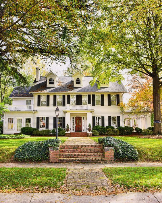 Inspiring homes - Reminds us of the house from Father of the Bride! Traditional white historic colonial style home with dormers, black shutters, brick walkway. #houses #housedesign #homedesign #tradtionalhome #oldhouses #historichomes #southernliving #homes #homedecor #exteriordesign #traditionaldesign #housegoals #homesweethome #southerncharm #entry #doors #frontdoor #townandcountry #housebeautiful