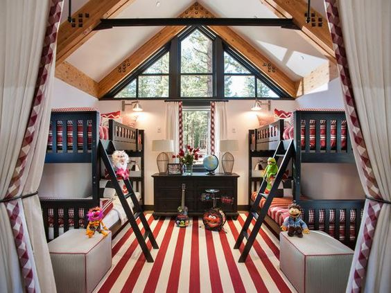 The vaulted ceilings, exposed wood beams and light-filled windows give this kids' room from the 2014 HGTV Dream Home a treehouse feel. The stacked bunk beds can sleep four.