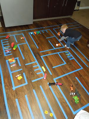 Use blue tape to make city! This will be great if Eli likes playing with cars one day!: