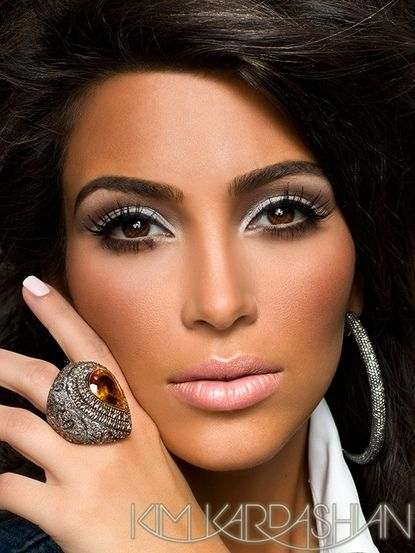 I AM NOT a Kim fan, but lovin' her make up. This is the tutorial on how to do this...