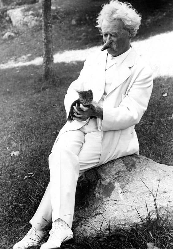 Mark Twain with a kitten in Tuxedo Park, New York, 1907. From the Mark Twain Papers, Bancroft Library, UC Berkeley.