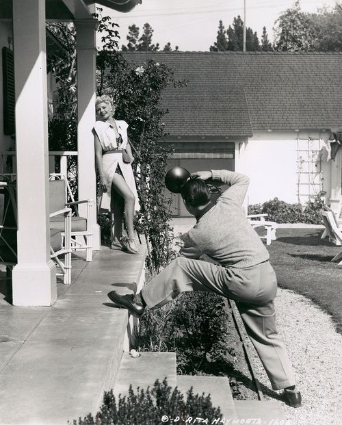 Rita Hayworth in her home being photographed by Eddie Cronenweth for The Lady From Shanghai (1947, dir. Orson Welles).