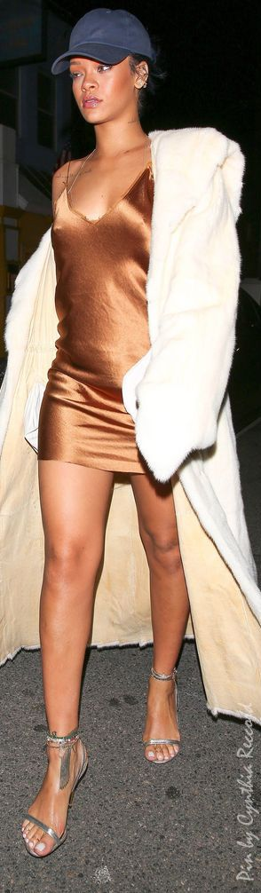 Rihanna in a Bronze slip dress with a white duster coat + baseball cap | cynthia reccord