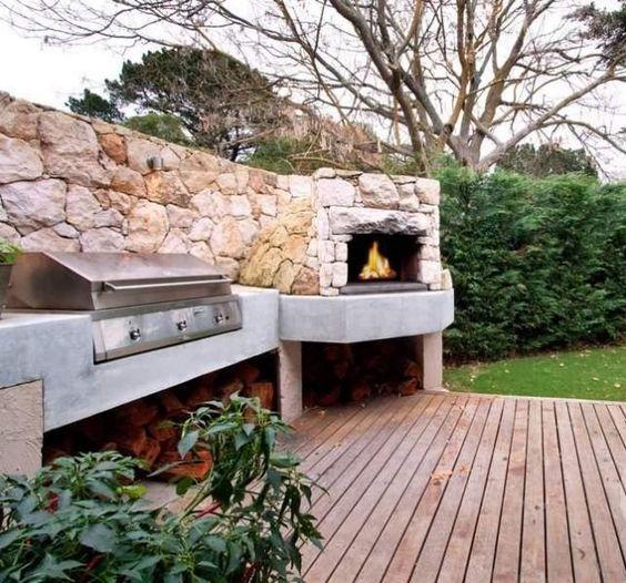 terrasse de jardin avec chemin e en pierre et barbecue encastr