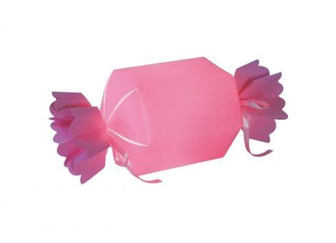 LAMPADA DA TAVOLO CARAMELLA ROSA. Lampada da tavolo a forma di caramella di colore rosa con due piccoli nastri di raso che vanno legati all'estremità alimentato a corrente.