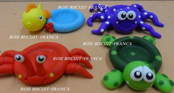 porta docinhos fundo do mar,tartaruga,peixinho,caranguejo,polvo,feito em biscuit. <br> <br>largura base interna:3 cm