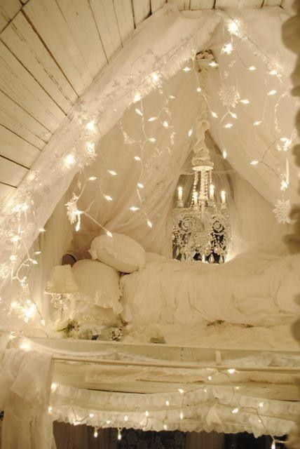 Fairy lights over beautiful white bed
