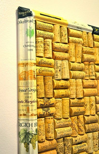 decoupaged wine labels on an old frame - perfect for a wine cork memo board
