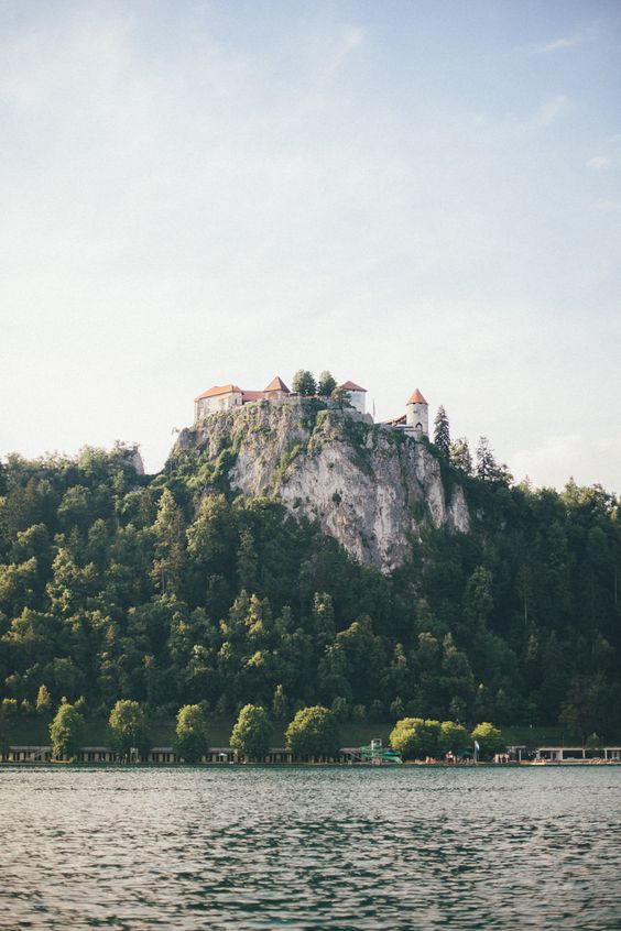 The emerald green lake, a medieval castle clinging to a rocky cliff and gigantic mountains offered a picture perfect backdrop for the wedding ceremony.