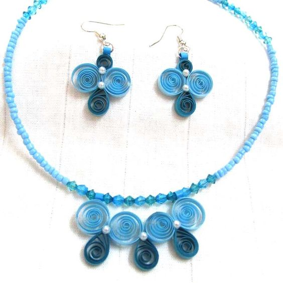 Paper quilled necklace and earrings with matching beads.