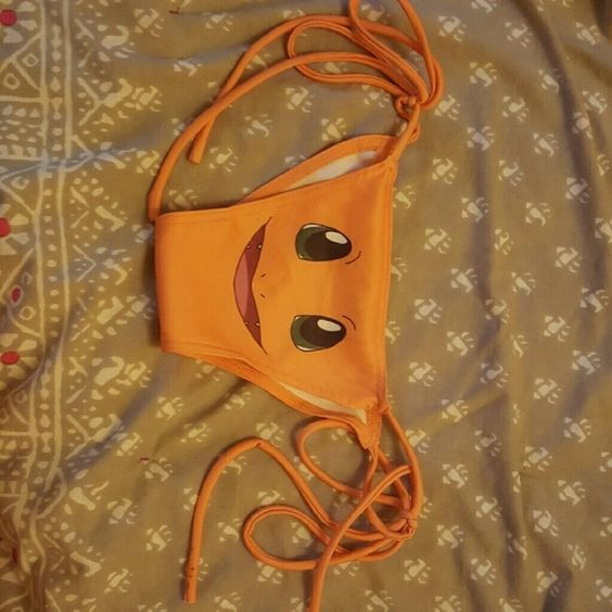 O-mighty Charmander Bikini bottoms Just bought these from another seller and they don't even begin to fit. Waaaay too small. These are a M and I usually wear a small. :( They are the cutest bottoms ever. There is a tiny bit of black ink on the string but otherwise, in excellent condition. O-mighty  Swim Bikinis