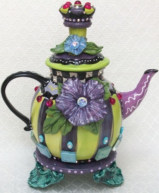 "Royal-tea Teapot, 10""W X 12""H, over 150 Swarovski crystals with glass tiles."