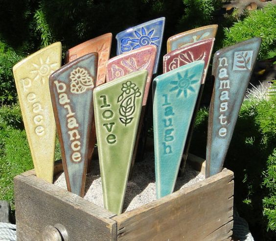 Inspiring garden stakes. Going to do a DIY of these today with the kid.