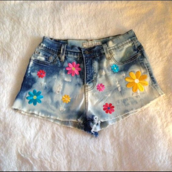 Short Shorts Cut offs with flowers , distressed. 10 p measure 12 1/2 inches laying flat. Price is firm. Please be advised these are custom cut, dyed and distressed. There may be a few imperfections which does not affect the product. Levi's Jeans