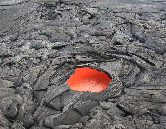 skylight.jpg: Skylight (view onto the flowing lava inside a lava tube) on the east breakout on Kilauea volcano. It ...