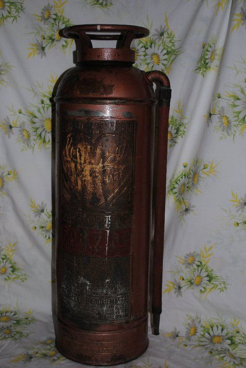 ELK HARD VINTAGE BRASS FIRE EXTINGUISHER - JUST BEGINNING TO BRING THIS ONE BACK TO LIFE. THIS WAS THE FIRST WIPE OF CHEMICAL TO REVEAL THE GRAPHIC UNDER ALL THE TARNISHED BRASS. STILL HAS THE ORIGINAL RED HOSE AND SOUNDS LIKE THE BOTTLE IS STILL INSIDE, WE'LL SEE.