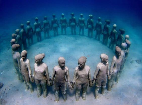 [IMAGE OF THE DAY] GRENADA'S UNDERWATER SCULPTURES: A TRIBUTE TO FALLEN AFRICAN SLAVES   Located in Grenada's Moilinere Bay, Jason de Caires Taylor's underwater sculptures are a momument created to pay homage to the hundreds of slaves that sought freedom or were forced to jump overboard slave ships travelling through the Middle Passage from West Africa to the Americas and the Caribbean.