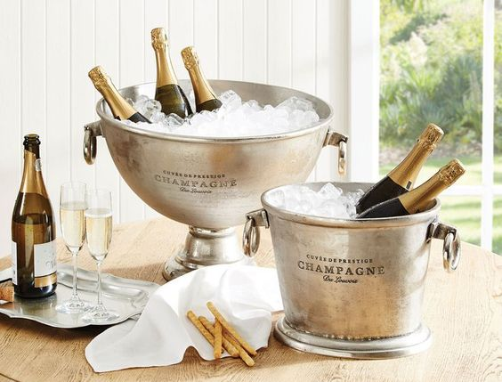 Creative ways to use and decorate with champagne buckets.