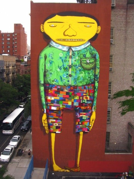 OsGemeos and Futura2000 in NYC Street artists Futura2000 and OsGemeos have recently finished the new mural in Chelsea, New York. It is located on 21st Street.
