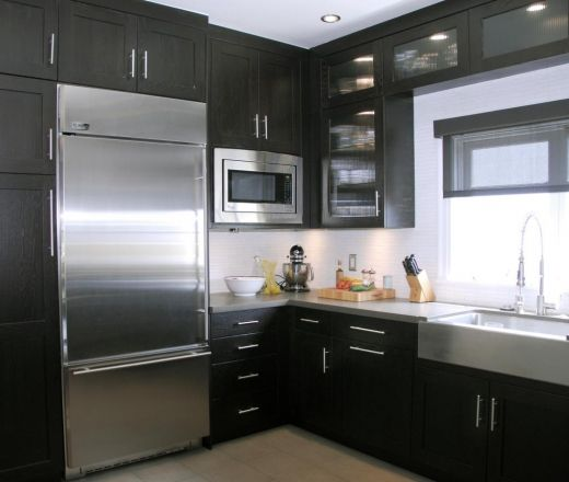 A Transitional L Shaped Modern Kitchen Design Featuring Black Cabinets Against White Walls