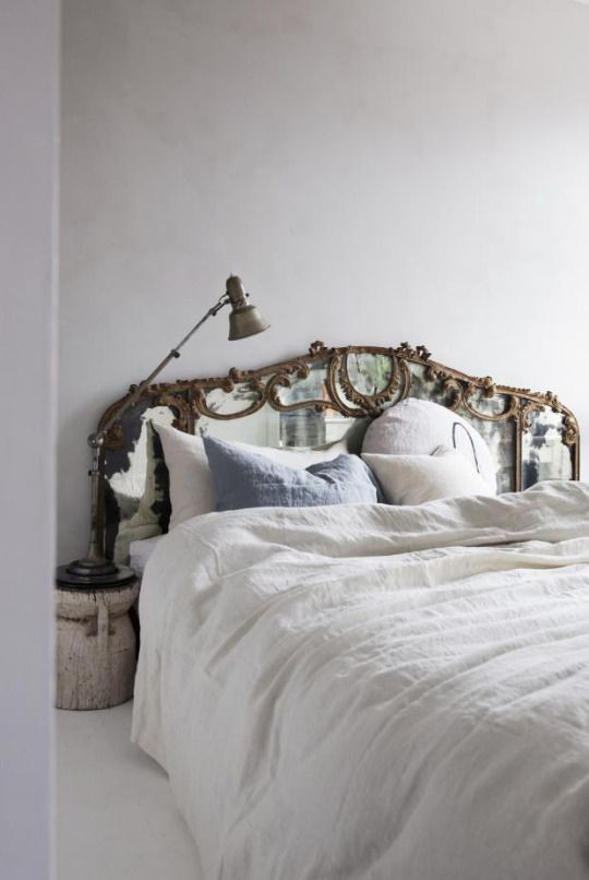 Blue, off white, anitique gold. Bed, bedroom. Calming colour palette.